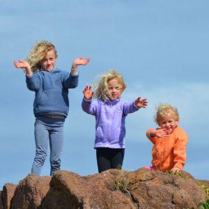 3-kids-standing-on-rock-outdoor