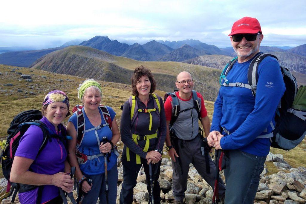 hill walking happy group team summit munro scotland